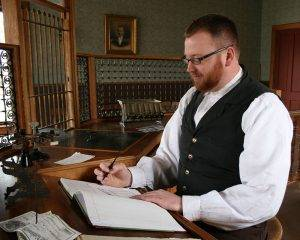 interpreter writes in the ledger at the bank