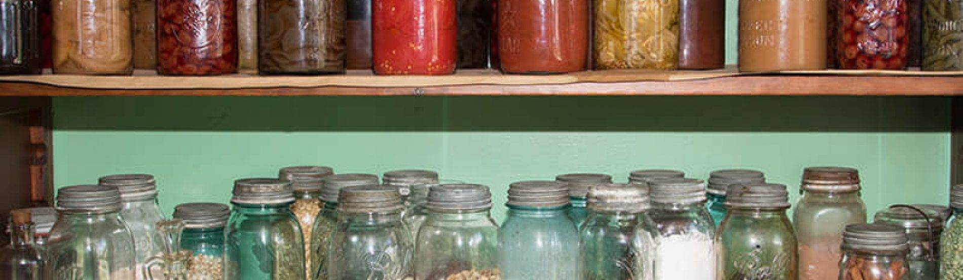 pantry stocked with glass jars of food and ingredients