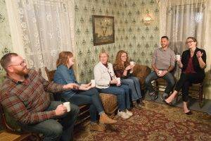 guests laugh in the 1900 farmhouse parlor