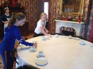 girls set the table at Flynn Mansion
