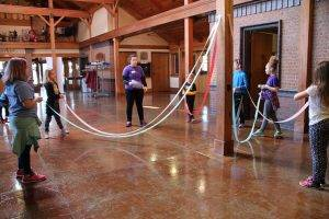 kids recreate a maypole at spring break camp