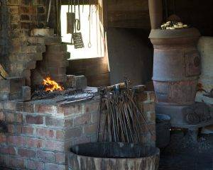 fire and tools in blacksmith shop