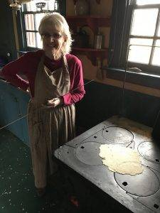 participant uses wood-burning stove