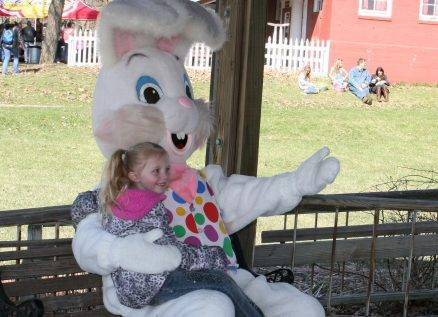 girl takes photo with easter bunny at family easter event