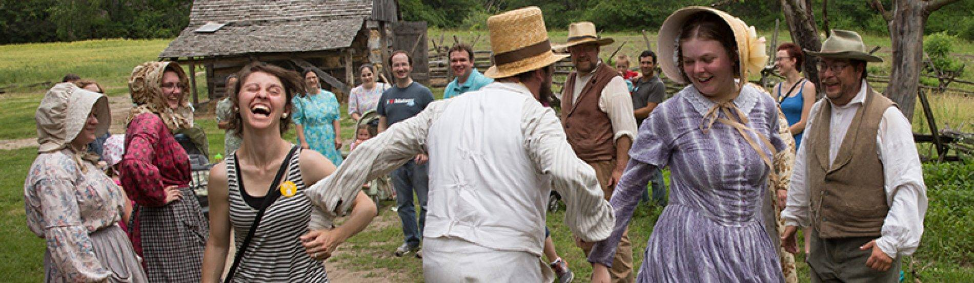 guests and interpreters dance at 1850 pioneer farm