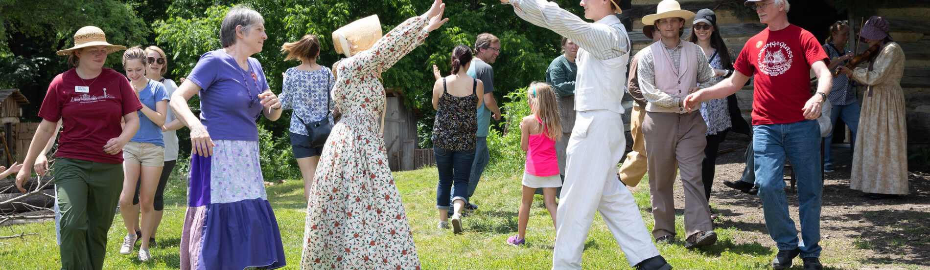 interpreters and visitors dance at the pioneer wedding