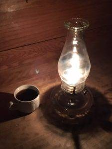coffee cup next to a lantern