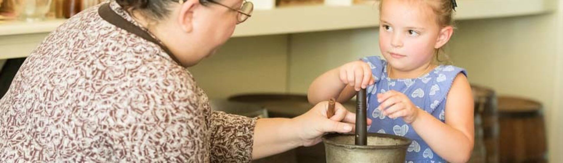 girl uses a mortar and pestle in the drug store