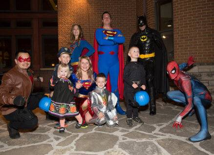 superheroes and kids at Family Halloween