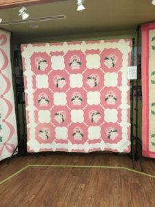quilt featuring pink floral design
