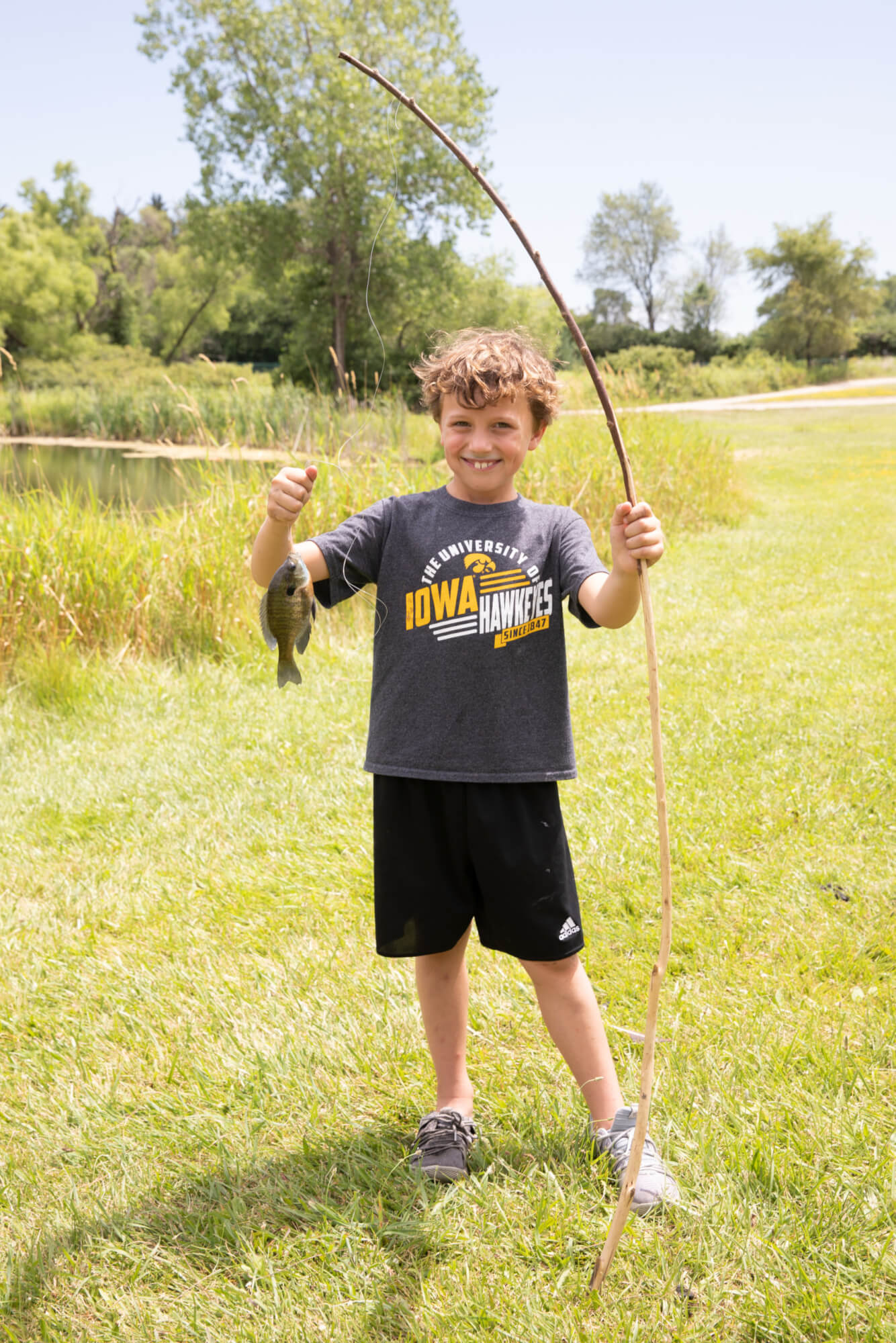 boy fishing at day camp