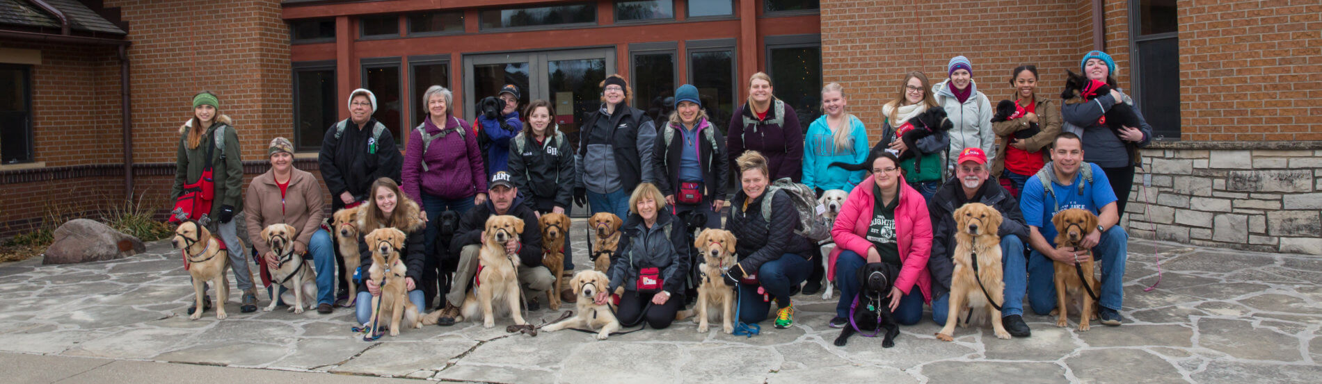 group shot of dogs and trainers/owners