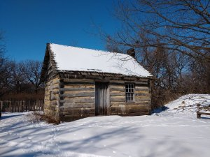 log house in snow