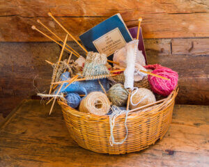 Basket with yarn and knitting needles.